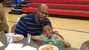 Dad and Son at the Watch DOG Pizza Party