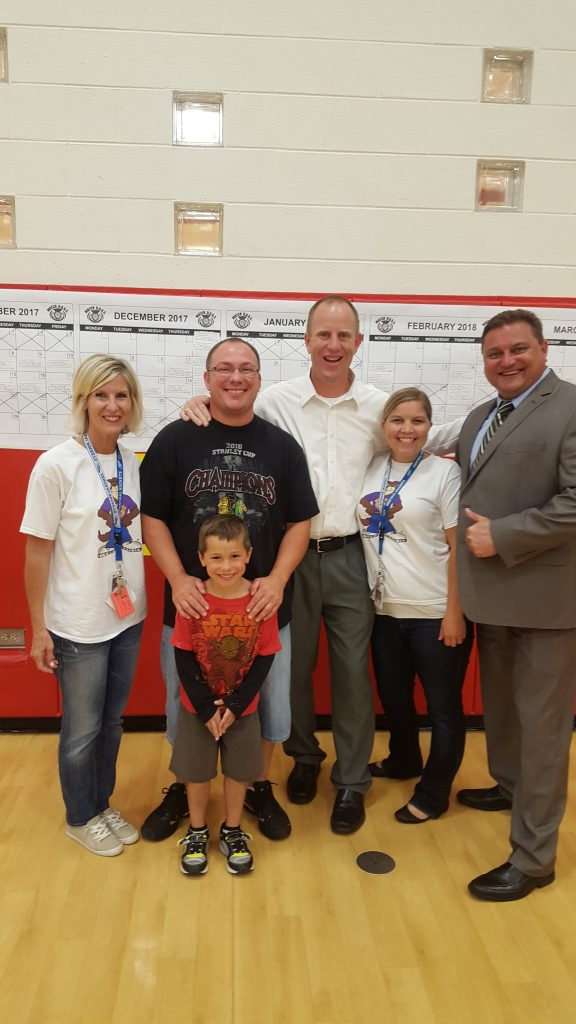 Dr. Stirn, Dr. King, Mrs. Kroeger, Ms. Dorsey, with a dad and his son